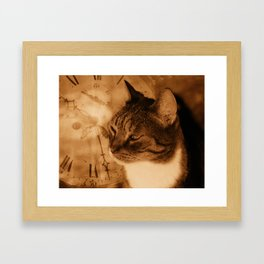 Cat and clock Framed Art Print