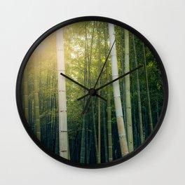 Sun shining through Arashiyama Bamboo Forest in Kyoto, Japan Wall Clock
