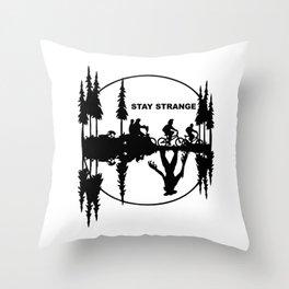 Stay Strange black Throw Pillow