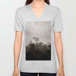 A tree standing tall in the clouds Unisex V-Neck