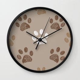 Brown colored paw print with light brown background Wall Clock