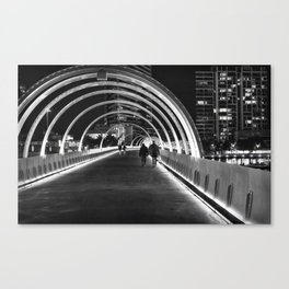 People walking on the bridge at night Canvas Print