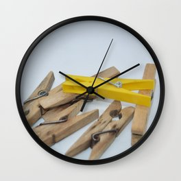 Clothespins to support the laundry while drying in the background Wall Clock