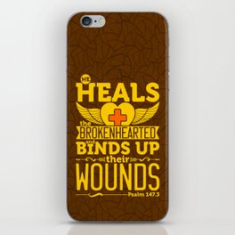 He heals the brokenhearted and binds up their wounds. iPhone Skin