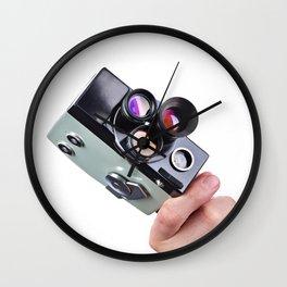 Retro mechanical movie camera in hand of  operator Wall Clock