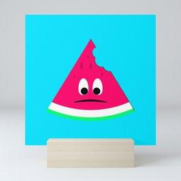 Cute sad bitten piece of watermelon Mini Art Print