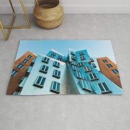 LOW ANGLE PHOTOGRAPHY OF BUILDING WITH CLOSED WINDOWS Rug