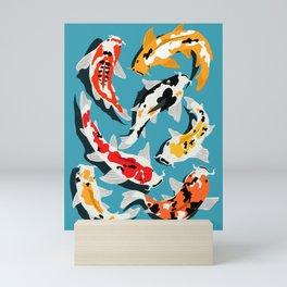 Colorful Koi Carps Swimming Around Mini Art Print