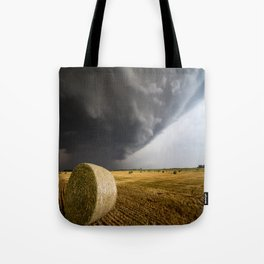 Spinning Gold - Storm Over Hay Bales in Kansas Field Tote Bag