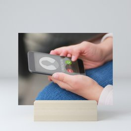 Close up of woman's hands with smartphone and unknown incoming phone call on it, fraud or scam schemes Mini Art Print