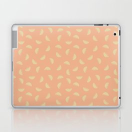 Bowl of falling fruit orange background Laptop & iPad Skin