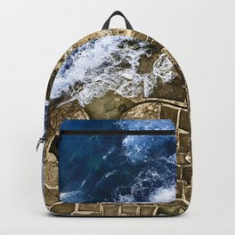 An abstract of the ocean and the coastal rocks. Backpack