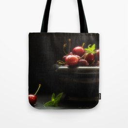 Noble Cuisine Still life with fresh cherries and black background Tote Bag
