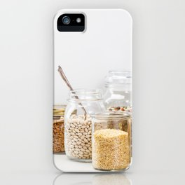 grains, legumes and nuts on concrete background iPhone Case