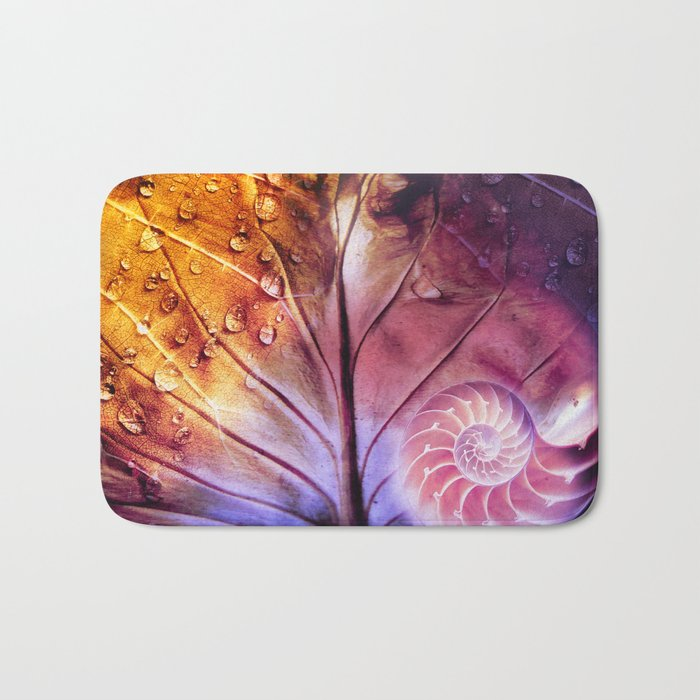 SHELTERED - Conceptual Composing with shell, leaf and waterdrops Bath Mat