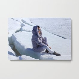 Girl in warm down-padded coat enjoys a look at snow top. Metal Print