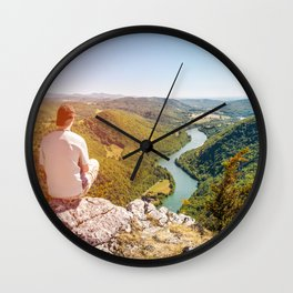 Rear view men looking at Ain valley mountains in summer Wall Clock