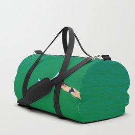 Woman swimming in green waters in Brazil Duffle Bag