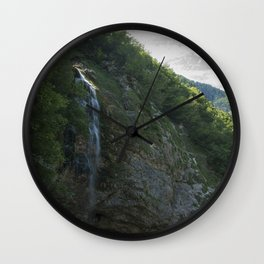 A small waterfall in the mountains Wall Clock