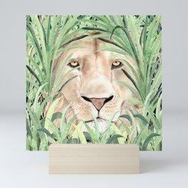 Lion staring through savanna grass, watercolor art.  Mini Art Print