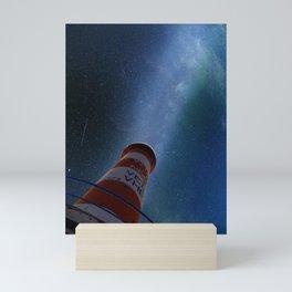 Lighthouse under starry sky Mini Art Print