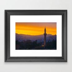 A minaret engulfed by birds Framed Art Print