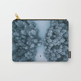 Man lying in the snow on a frozen lake in a winter forest - Landscape Photography Carry-All Pouch