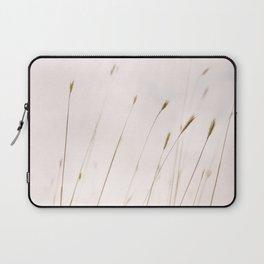 Tall grass against cloudy sky Laptop Sleeve