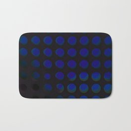 An abstract array of holes in metal and glass Bath Mat