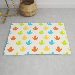 Cute Dinosaurs Footprints Nursery Illustration in Green Blue Yellow and Red Rug