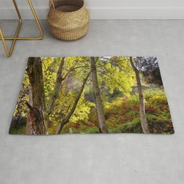 bright leaves in dense forest Rug