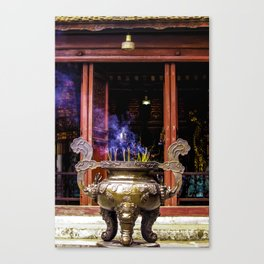 Gold Urn with Incense Sticks Burning by a Red Altar at the Ngoc Son Temple in Hanoi, Vietnam Canvas Print