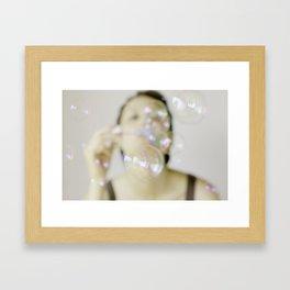 Blowing soap bubbles Framed Art Print