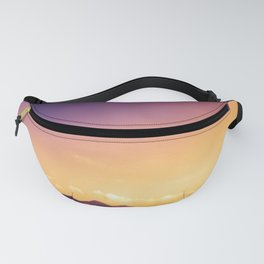 sunset over the mountains Fanny Pack