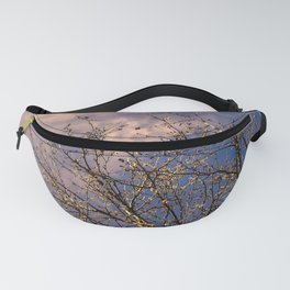 tree in spring and cloudy sky Fanny Pack