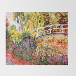 "Claude Monet ""Water lily pond, water irises"" Throw Blanket"