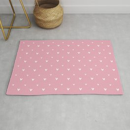 Small sketchy white hearts pattern on pink background Rug