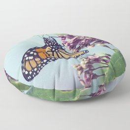 Monarch butterfly perched on pink swamp milkweed flowers Floor Pillow