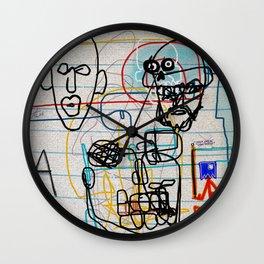 VARIATION: SKULLS, FACES, WORDS, LETTERS, A HELMET, A HOOD, & A MASK Wall Clock