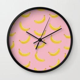 Banana in pink Wall Clock