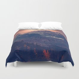 Beautiful Mountain Snow Capped landscape With Green Pine Trees Glowing pink Sunset Behind It Duvet Cover