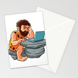 Cartoon caveman using a laptop. Stationery Cards