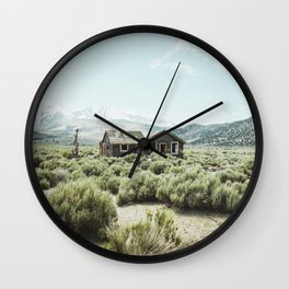 Old house in desert Wall Clock