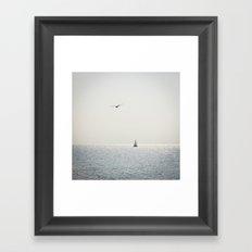 Fly over the sea Framed Art Print