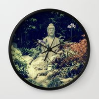 om Wall Clocks featuring OM  by Lucca Nazario