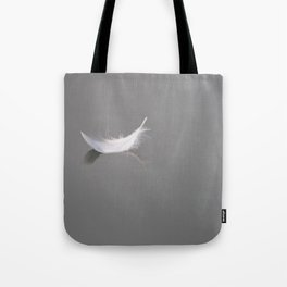 Swan feather drifting on the river Tote Bag