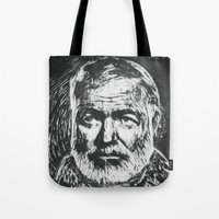 hemingway Tote Bags featuring Ernest Hemingway portrait by Psychedelic Astronaut