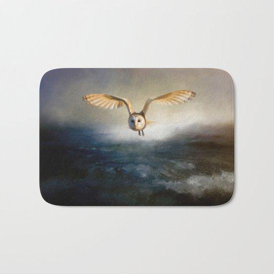 An owl flies over the lake Bath Mat