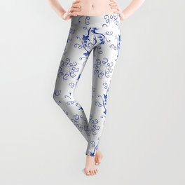 Blue floral ornament on a white background Leggings