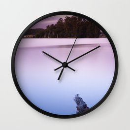 Sunset with pink sky and blue lake Wall Clock